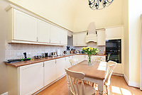 BNPS.co.uk (01202 558833)<br /> Pic: Symonds&Sampson/BNPS<br /> <br /> Kitchen. <br /> <br /> A charming home which features in a Thomas Hardy novel has emerged on the market for £500,000.<br /> <br /> Grade II listed Stinsford House, in the idyllic village of Stinsford, Dorset, is referenced in the writer's 1872 novel 'Under The Greenwood Tree'.<br /> <br /> It is believed that the tree in the courtyard is the one Hardy wrote about in the romantic tale.<br /> <br /> Hardy was very attached to the village which is on the outskirts of the market town of Dorchester. He was baptised at St Michael's Church in the village and his church group is thought to have performed at the 17th century property every Christmas Eve. Following his death in 1928, his second wife fulfilled Hardy's request for his heart to be buried at St Michael's Church, while his ashes were interred at 'Poets Corner' in Westminster Abbey.<br /> <br /> The property is being sold with estate agent Symonds & Sampson.