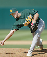Chad Bradford of the Oakland Athletics pitches during a 2002 MLB season game against the Los Angeles Angels at Angel Stadium, in Anaheim, California. (Larry Goren/Four Seam Images)