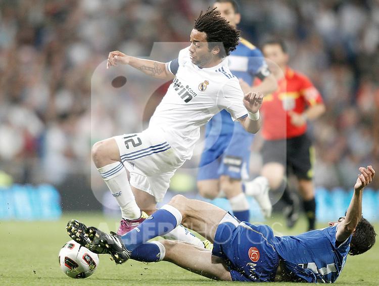 Real Madrid's Marcelo against Getafe's Angel Arizmendi during La Liga Match. May 10, 2011. (ALTERPHOTOS/Alvaro Hernandez)