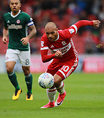 30th September 2017, Riverside Stadium, Middlesbrough, England; EFL Championship football, Middlesbrough versus Brentford; Martin Braithwaite of Middlesbrough runs with the ball with Nico Yennaris of Brentford in the background in the 2-2 draw