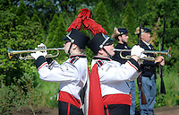 IVYLAND, PA - MAY 26:  William Tennent Marching band members Claire Linder (L), and Joshua Reed, both of Warminster, Pennsylvania play TAPS during the Ivyland Memorial Day Parade and Ceremony May 26, 2014 in Ivyland, Pennsylvania. (Photo by William Thomas Cain/Cain Images)