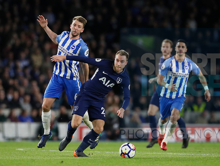Dale Stephens of Brighton and Christian Eriksen of Tottenham during the premier league match at the Amex Stadium, London. Picture date 17th April 2018. Picture credit should read: David Klein/Sportimage