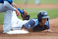 Cole Peterson (19) of the West Michigan Whitecaps dives head first back into first base during the game against the South Bend Cubs at Fifth Third Ballpark on June 10, 2018 in Comstock Park, Michigan. The Cubs defeated the Whitecaps 5-4.  (Brian Westerholt/Four Seam Images)