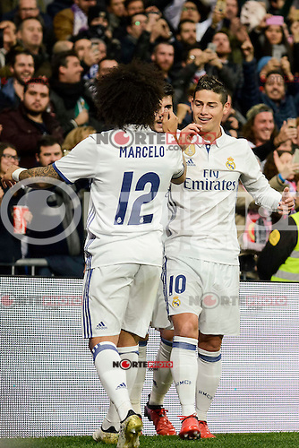 Real Madrid's Marcelo and James Rodriguez during Copa del Rey match between Real Madrid and Sevilla FC at Santiago Bernabeu Stadium in Madrid, Spain. January 04, 2017. (ALTERPHOTOS/BorjaB.Hojas) NortePhoto.com