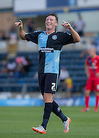 Garry Thompson of Wycombe Wanderers celebrates as Wycombe go 3-0 up during the Sky Bet League 2 match between Wycombe Wanderers and York City at Adams Park, High Wycombe, England on 8 August 2015. Photo by Andy Rowland.
