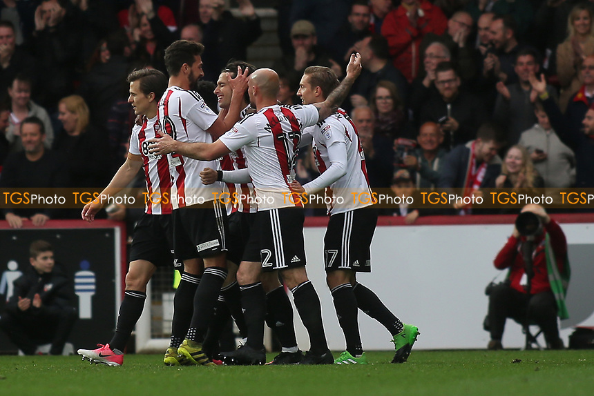Brentford players congratulate Jota after scoring their fourth goal during Brentford vs Derby County, Sky Bet EFL Championship Football at Griffin Park on 14th April 2017