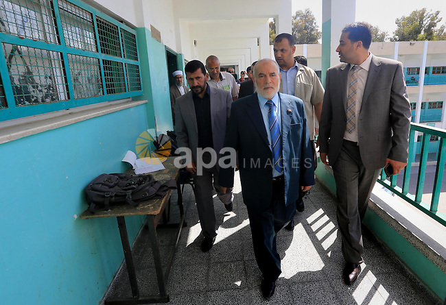 "Deputy of the Legislative Council, Ahmed Bahar, visits a school during the first day of high school exams, known as ""Tawjihi"", in Gaza city on May 30, 2015. Nearly 81,000 Palestinian students sat for the first session of their high school exams seeking to obtain the General Secondary Certificate, or Tawjihi, across the West Bank and the Gaza Strip on Saturday. Photo by Mohammed Asad"
