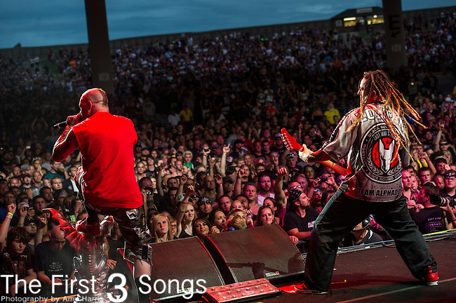 Ivan Moody and Zoltan Bathory of Five Finger Death Punch performs during the 2013 Mayhem Festival at Klipsch Music Center in Indianapolis, Indiana.