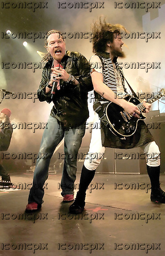 Guns n' Roses - Axl Rose andguitarist Robin Finck  - performing live at the Hammerstein Ballroom in New York USA - 15 May 2006.  Photo credit: George Chin/IconicPix