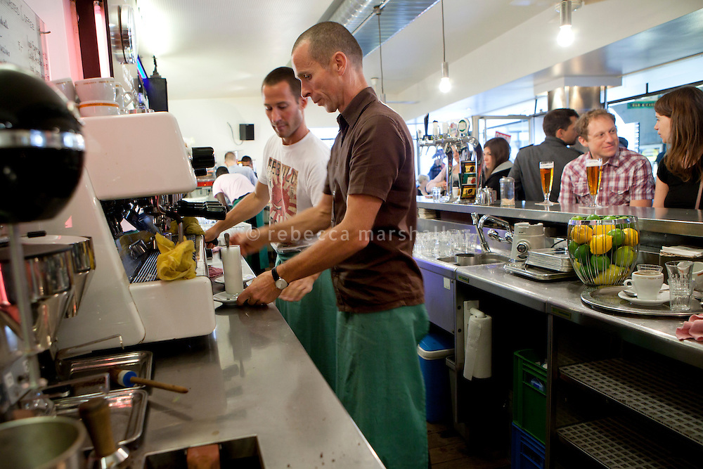 Baristas work at the coffee machine at Adrianos, Theaterplatz, Bern, Switzerland, 27 August 2011