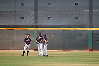 AZL Indians Blue outfielders Will Brennan (30), Cristopher Cespedes (17), and Julian Escobedo (4) during a pitching change in an Arizona League game against the AZL Indians Red on July 7, 2019 at the Cleveland Indians Spring Training Complex in Goodyear, Arizona. The AZL Indians Blue defeated the AZL Indians Red 5-4. (Zachary Lucy/Four Seam Images)