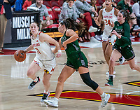 COLLEGE PARK, MD - DECEMBER 8: Taylor Mikesell #11 of Maryland dribbles past Stephanie Karcz #10 of Loyola during a game between Loyola University and University of Maryland at Xfinity Center on December 8, 2019 in College Park, Maryland.