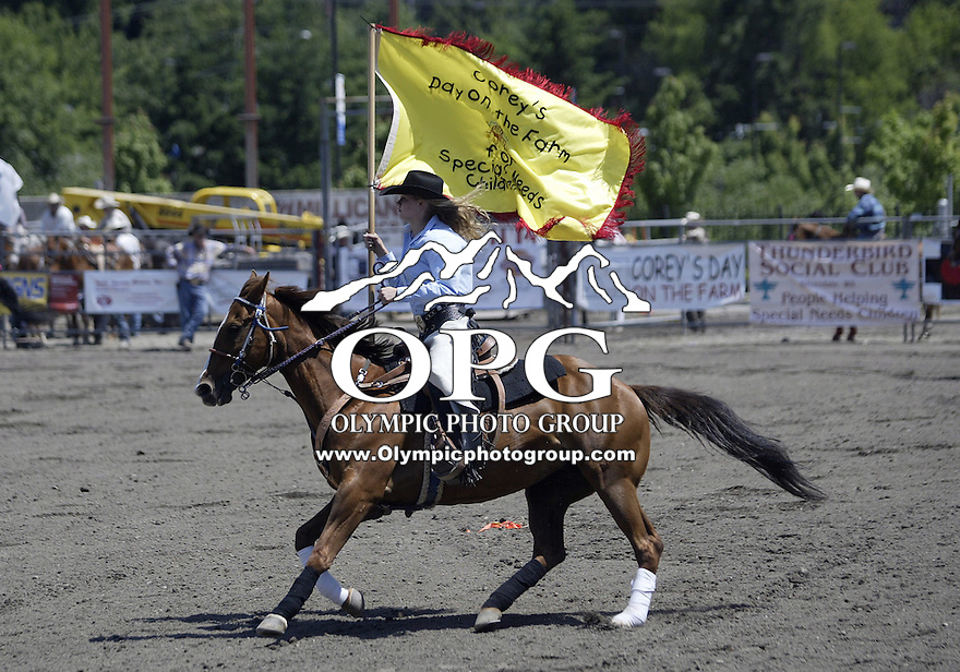 29 June 2008:  Rodeo royalty and princesses brought in the flags of colors before the national anthem at the ThunderBird Pro Rodeo in Bremerton, Washington.