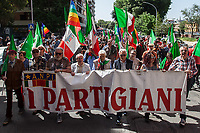 """Rome, 25/04/2018. Today, to mark the 73rd Anniversary of the Italian Liberation from nazi-fascism ('Liberazione'), ANED Roma & ANPI Roma (National Association of Italian Partizans) held a march ('Corteo') from Garbatella to Piazzale Ostiense where a rally took place attended by Partizans, Veterans and politicians – including the Mayor of Rome and the President of Lazio's Region. FOR THE FULL CAPTIONS PLEASE CHECK """"Photo Stories - 2010 to Today"""". Rome, 25/04/2020. Today is the 25 Aprile, the Day which marks the Italian Liberation from nazi-fascism: la Liberazione. The 75th Anniversary is remembered and commemorated in this story with the Partigiani (Partizans) and the greatest achievements of their fight, struggle, suffering and deaths: the Freedom, the Italian Constitution, and the Future of Italy and Europe without dictatorships. Rome, 25/04/2020. Today is the 25 Aprile, the Day which marks the Italian Liberation from nazi-fascism: la Liberazione. The 75th Anniversary is remembered and commemorated in this story with the Partigiani (Partizans) and the greatest achievements of their fight, struggle, suffering and deaths: the Freedom, the Italian Constitution, and the Future of Italy and Europe without dictatorships. Rome, 25/04/2020. Today is the 25 Aprile, the Day which marks the Italian Liberation from nazi-fascism: la Liberazione. The 75th Anniversary is remembered and commemorated in this story with the Partigiani (Partizans) and the greatest achievements of their fight, struggle, suffering and deaths: the Freedom, the Italian Constitution, and the Future of Italy and Europe without dictatorships."""