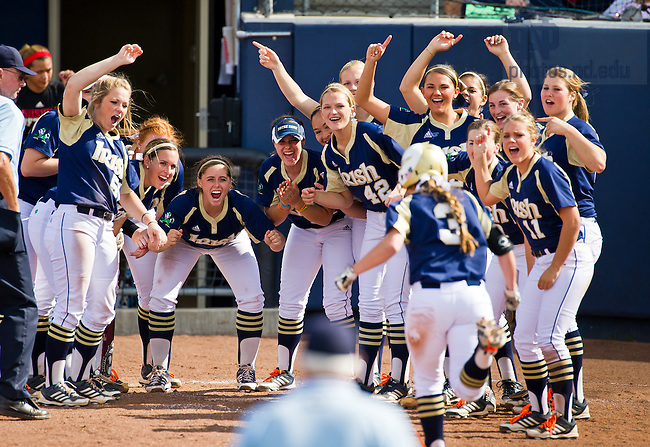 May 4, 2013; The Softball team celebrates as Emilee Koerner (3) heads for home plate after a home run...Photo by Matt Cashore/Univeristy of Notre Dame
