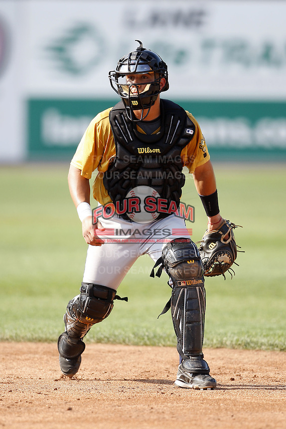 June 24, 2009:  Catcher Tony Sanchez of the State College Spikes takes infield in full gear before a game at Eastwood Field in Niles, OH.  The State College Spikes are the NY-Penn League Short Season-A affiliate of the Pittsburgh Pirates.  Photo by:  Mike Janes/Four Seam Images