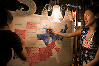 A presidential election party at Cafe D'Mongo's Speakeasy in Detroit, Michigan. Margaret (right) and her friend are colouring the states on a map (red for the Republican John McCain and blue for the Democratic candidate Barack Obama) as the results come in.