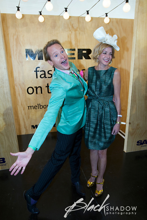 Author Candace Bushnell and fashion guru Carson Kressley as Fashions on the Field celebrity guests at the 2008 Melbourne Cup race day.