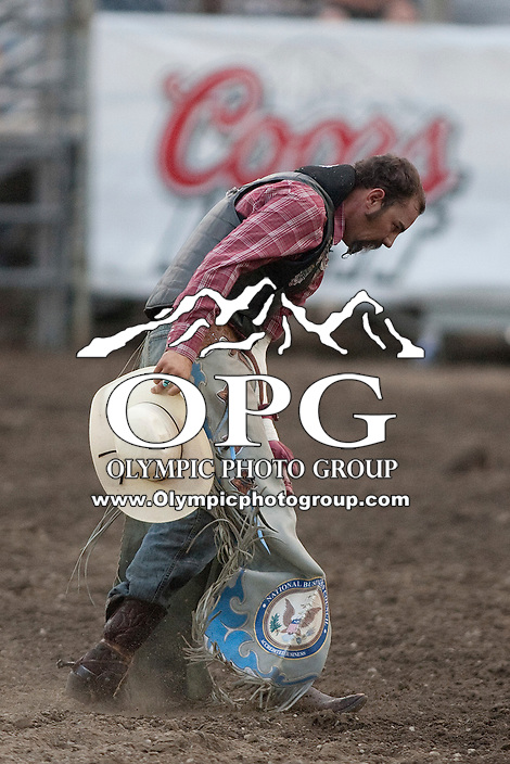 24 Aug 2011:  Shannon Miller was not able to score while riding the horse Broken Lady in the Bareback Riding competition at the Kitsap County Fair and Stampede Rodeo in Bremerton, Washington.