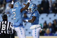 CHAPEL HILL, NC - NOVEMBER 23: Rontavius Toe Groves #4 and Dyami Brown #2 of the University of North Carolina celebrate in the end zone during a game between Mercer University and University of North Carolina at Kenan Memorial Stadium on November 23, 2019 in Chapel Hill, North Carolina.