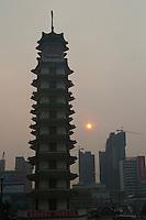 Evening landscape view of the Erqi Monument Tower at Erqi Square in the Guǎnchéng Huízú Qū of Zhengzhou in Henan province.  © LAN