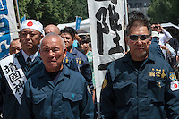 Right-wing paramilitary groups called Uyoku, parade during the 70th anniversary celebrations of the end of the Pacific war  at the controversial Yasukuni Shrine in Kudanshita, Tokyo, Japan Saturday August 15th 2015