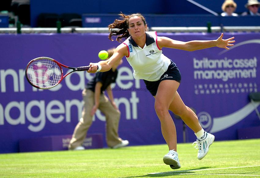 Photo. Rene Solari..21/6/01  .Eastbourne Day 4.  Italian Silvia Farina Elia puts her speed to work as she dashes across the court to return the ball to Lindsay Davenport...
