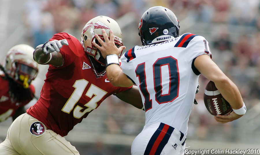 TALLAHASSEE, FL 9/4/10-FSU-SAMFORD FB10 CH-Florida State's Nigel Bradham gets a facefull of hand from  Samford quarterback Dustin Taliaferro during first half action Saturday at Doak Campbell Stadium in Tallahassee. The Seminoles beat the Bulldogs 59-6 to give Head Coach Jimbo Fisher his first victory..COLIN HACKLEY PHOTO