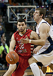 January 21, 2012:   Fresno State Bulldogs #12 Steven Shepp drives past Nevada Wolf Pack forward Olek Czyz in the first half during their NCAA game played at Lawlor Events Center in Reno, NV.