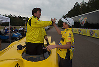 Mar. 17, 2013; Gainesville, FL, USA; NHRA super gas driver Troy Coughlin Jr celebrates with a crew member after winning the Gatornationals at Auto-Plus Raceway at Gainesville. Mandatory Credit: Mark J. Rebilas-