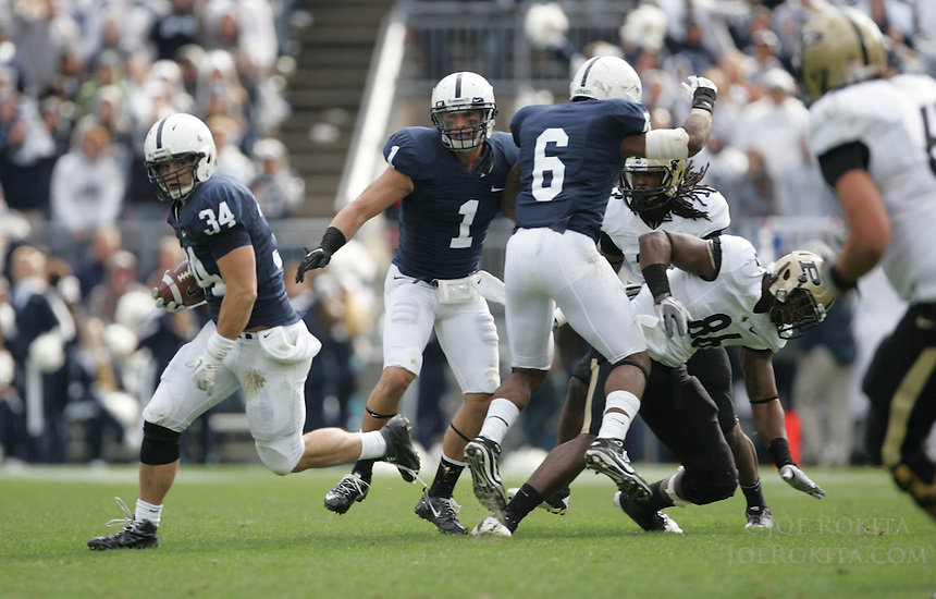 State College, PA - 10/15/2011:  Nate Stupar returns one of his two interceptions during the game.  Penn State defeated Purdue by a score of 23-18 on October 15, 2011, homecoming, at Beaver Stadium...Photo:  Joe Rokita / JoeRokita.com..Photo ©2011 Joe Rokita Photography