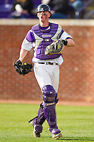 High Point Panthers catcher Spencer Angelis #11 on defense against the Manhattan Jaspers at Willard Stadium on March 9, 2012 in High Point, North Carolina.  The Panthers defeated the Jaspers 11-6.  (Brian Westerholt/Four Seam Images)