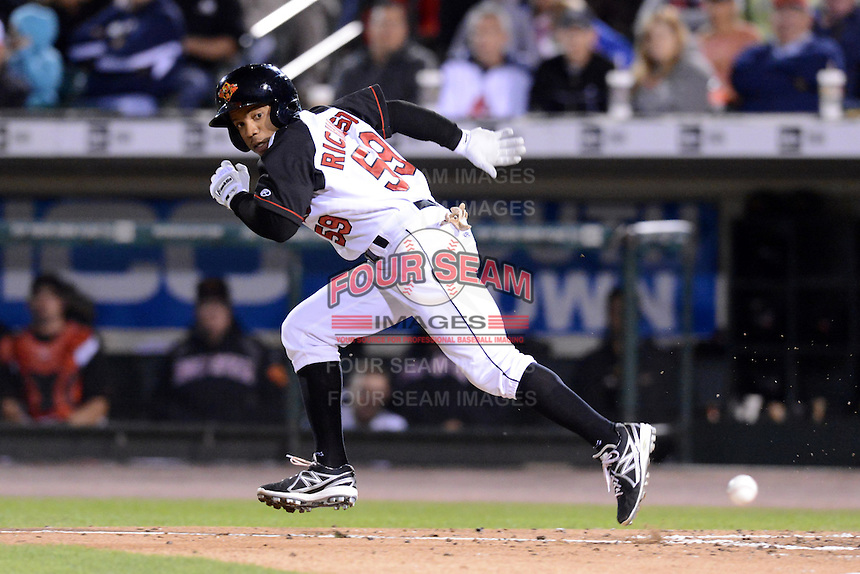 Rochester Red Wings outfielder Antoan Richardson (59) bunts during an International League playoff game against the Pawtucket Red Sox on September 5, 2013 at Frontier Field in Rochester, New York.  Pawtucket defeated Rochester 7-2.  (Mike Janes/Four Seam Images)