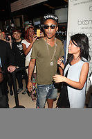 NEW YORK, NY - SEPTEMBER 6: Pharrell Williams  attends Fashion's Night Out at Bloomingdale's  in New York City, NY. September 6, 2012. © Diego Corredor/MediaPunch Inc.