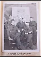 BNPS.co.uk (01202 558833)<br /> Pic: C&amp;T/BNPS<br /> <br /> Captain Lees (front right) pictured with other officers.<br /> <br /> A remarkable collection of images of Nazi high ranking officers at a Welsh prisoner of war camp in the aftermath of the Second World War have been unearthed after 70 years.<br /> <br /> Senior figures including Gerd von Rundstedt who was commander in chief of the German army in the campaign against France in 1940 were held at Island Farm Prisoner of War camp near Bridgend while awaiting the Nuremburg Trials.<br /> <br /> In one startling image, Rundstedt is greeted at a train station by a British officer, while another image shows the field marshal being saluted by the other prisoners upon his return from the Nuremburg Trials.<br /> <br /> The fascinating collection of photographs, documents and letters, which were compiled by the camp's intelligence officer, Captain Ted Lees, has emerged for auction through a private collector and is tipped to sell for &pound;5,000.