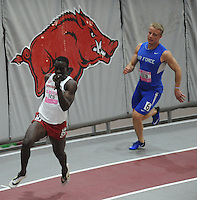 NWA Democrat-Gazette/ANDY SHUPE<br /> Arkansas junior Kemar Mowatt (left) pulls away from Air Force senior Zach Johnson as they compete in the 200 meters Saturday, Feb. 11, 2017, during the Tyson Invitational in the Randal Tyson Track Center in Fayetteville. Visit nwadg.com/photos to see more photographs from the meet.