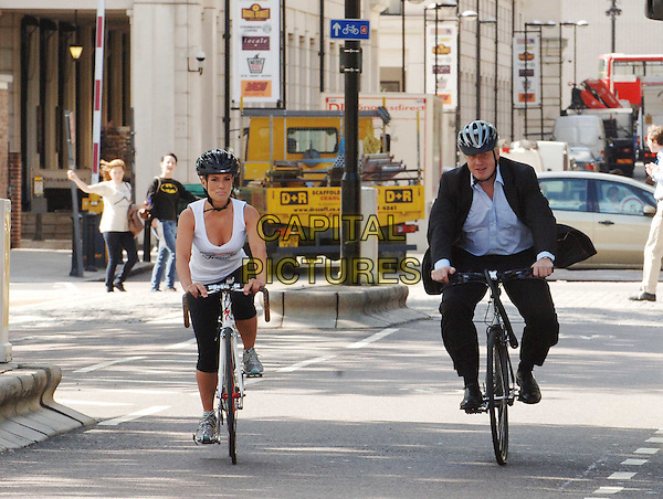 "GEORGIE THOMPSON & BORIS JOHNSON.The Mayor of London launches ""Summer of Cycling"" which aims to encourage more Londoners to take to their bikes, London, England..July 21st, 2008.full length black suit bicycle helmet blue shirt leggings white tank top riding .CAP/WIZ.© Wizard/Capital Pictures."