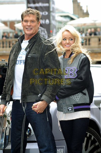 DAVID HASSELHOFF & HAYLEY ROBERTS.The start of Gumball 3000, Covent Garden, London, England..May 26th, 2011.half length couple jeans denim black jacket grey gray posing holding hands.CAP/WIZ.© Wizard/Capital Pictures.