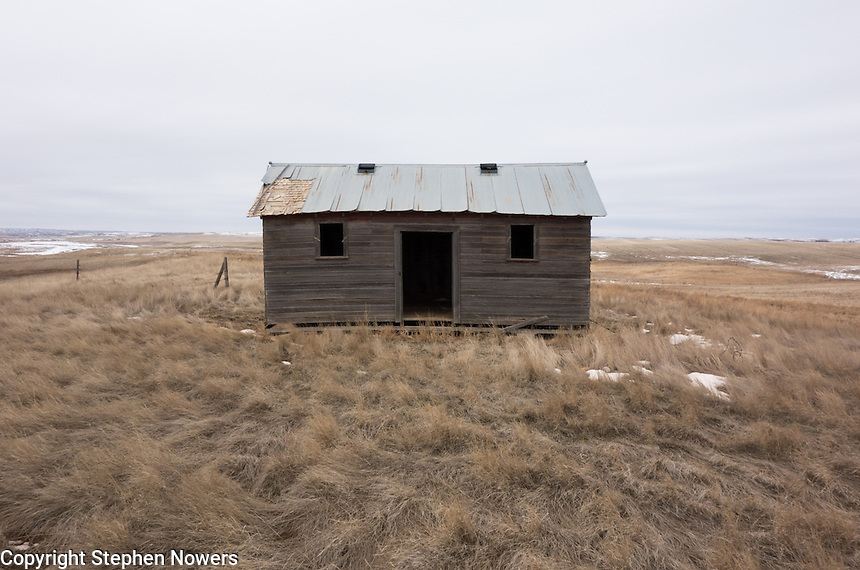 An abandoned farm building in a field near the North Dakota town of Arnegard.