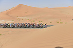 The peloton in the desert during Stage 3 of the 2019 UAE Tour, running 179km form Al Ain to Jebel Hafeet, Abu Dhabi, United Arab Emirates. 26th February 2019.<br /> Picture: LaPresse/Fabio Ferrari | Cyclefile<br /> <br /> <br /> All photos usage must carry mandatory copyright credit (© Cyclefile | LaPresse/Fabio Ferrari)