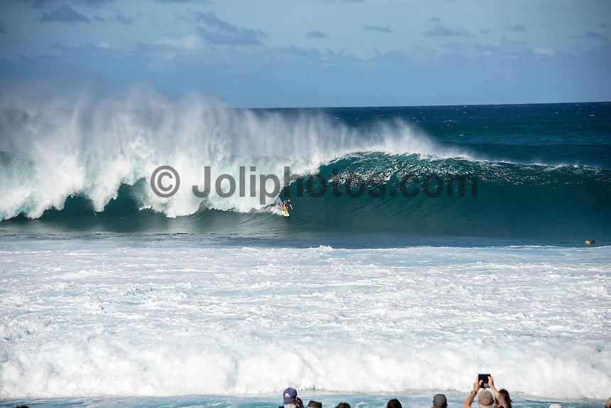 BANZAI PIPELINE, Oahu/Hawaii (Saturday, December 13, 2014) Glen Hall (IRE). - The final stop of the 2014  World Championship Tour, the Billabong Pipe Masters in Memory of Andy Irons, was  called ON today in NW double overhead surf. <br /> Round 1 was completed as the swell continued to rise and the Easterly Trade winds increased in strength. Kelly Slater (USA) kept his World Title hopes alive after winning his heat against Reef MacIntosh (HAW). Jordy Smith(ZAF) was injured when he hit the reef at Backdoor.<br /> Conditions worsen around the end of the Round and the event was first put on hold then postponed for the day.  <br /> <br /> The Billabong Pipe Masters in Memory of Andy Irons will determine this year&rsquo;s world surfing champion as well as those who qualify for the elite tour in 2015. As the third and final stop on the Vans Triple Crown of Surfing Series  the event will also determine the winner of the revered three-event leg.<br /> <br />  Photo: joliphotos.com