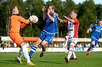 EMMEN - Voetbal, VV Emmen - FC Emmen, voorbereiding seizoen 2018-2019, 07-07-2018,  Ronald Falke is eerder bij de bal dan FC Emmen speler Jason Bourdouxhe