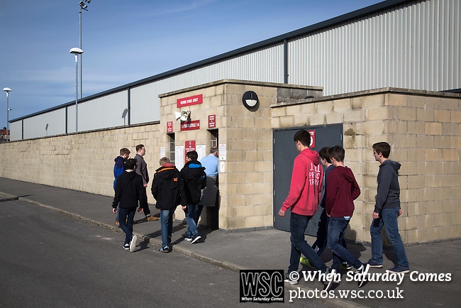 Morecambe 0 Plymouth Argyle 2, 25/03/2016. Globe Arena, League 2. Home fans entering the turnstiles at the Globe Arena before Morecambe hosted Plymouth Argyle in a League 2 fixture. The stadium was opened in 2010 and replaced Morecambe's traditional home of Christie Park which had been their home since 1921, the year after their foundation. Plymouth won this fixture by 2-0 watched by 2,081 spectators, in a game delayed by 30 minutes due to traffic congestion affecting travelling Argyle fans.  Photo by Colin McPherson.