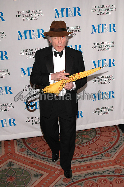 26 May 2005 - New York, New York - Dick Cavett shows off some dance moves as he arrives at The Museum of Television and Radio's Annual Gala where Merv Griffin is being honored for his award winning career in radio and television.<br />Photo Credit: Patti Ouderkirk