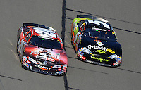 Sept. 27, 2008; Kansas City, KS, USA; NASCAR Nationwide Series driver Joey Logano (20) races alongside Mark Martin (5) during the Kansas Lottery 300 at Kansas Speedway. Mandatory Credit: Mark J. Rebilas-