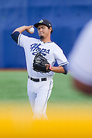 Carlos Hernandez (17) of the Hillsboro Hops plays catch in the outfield prior to making a start against the Tri-City Dust Devils at Ron Tonkin Field in Hillsboro, Oregon on August 24, 2015.  Tri-City defeated Hillsboro 5-1. (Ronnie Allen/Four Seam Images)