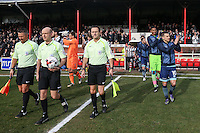 Captain Matt Bloomfield of Wycombe Wanderers leads the teams out with Officials during the Sky Bet League 2 match between Grimsby Town and Wycombe Wanderers at Blundell Park, Cleethorpes, England on 4 March 2017. Photo by Andy Rowland / PRiME Media Images.