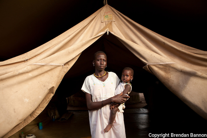 Nyakong and her child outside of the Therapeutic feeding center at MSF's hospital in Nasir, South Sudan.