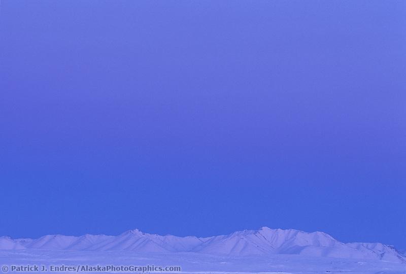 Snow covered Philip Smith Mountains of Alaska's Brooks range, Arctic coastal plain, Alaska.
