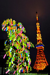 July 7th, 2012 : Tokyo, Japan -  A bamboo with people's wishes was lightened up as Tokyo Tower, one of Tokyo's famous sightseeing spots, was seen behind at Tanabata Festival, a traditional festival on July 7 every year, at Zojoji, or Zojo Temple, at Shibakouen, Minato, Tokyo, Japan on July 7, 2012.  Even though the festival was supposed to celebrate stars, it was raining and cloudy this year. (Photo by Koichiro Suzuki/AFLO)